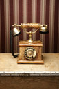 An Old Vintage Telephone On A Wooden Table Royalty Free Stock Image - 25625896