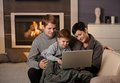 Happy Family With Computer Royalty Free Stock Photography - 25641807