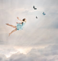Little Girl Flying At Twilight Stock Photography - 25666492