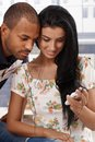 Young Couple Listening To Music Through Earbuds Stock Photos - 25700823
