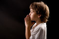 A Young Kid In A Spiritual Peaceful Moment Praying Stock Images - 25711964