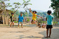 Children Playing Kra Dod Cheark (the Rope Jumpin Royalty Free Stock Images - 25722289
