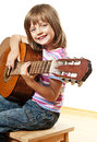 Little Girl Playing Classical Guitar Royalty Free Stock Images - 25739849