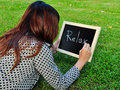 Woman Lie Down And Write Word On The Blackboard Royalty Free Stock Image - 25747776