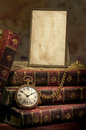 Frame With Old Photo Paper, Pocket Watch And Books Stock Image - 25758101
