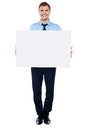 Businessman Holding Blank White Billboard Stock Images - 25762014