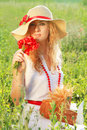 Woman In Hat With Poppy Bouquet Stock Images - 25769084