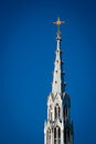 Golden Crucifix Atop Tall Church Steeple Royalty Free Stock Image - 25790806
