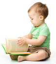 Cute Little Boy Reads A Book Royalty Free Stock Photo - 25800075