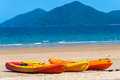 Kayaks Canoes Beach Tropics Stock Photos - 25814253
