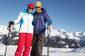 Couple Having Fun On Ski Holiday In Mountains Royalty Free Stock Image - 25837326