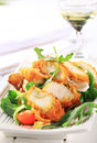 Breaded Chicken Breast With Salad Greens Royalty Free Stock Image - 25854736