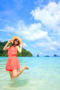 Asian Woman In A Pink Dress Standing On The Beach Stock Images - 25856974