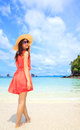 Asian Woman In A Pink Dress Standing On The Beach Stock Images - 25857004
