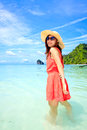 Asian Woman In A Pink Dress Standing On The Beach Royalty Free Stock Images - 25857089
