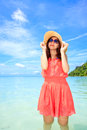 Asian Woman In A Pink Dress Standing On The Beach Royalty Free Stock Photo - 25857125