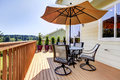 Deck With Table, Chairs And Umbrella. Royalty Free Stock Images - 25858989