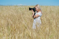 Woman Take A Photo With Camera In A Field Stock Photo - 25865440