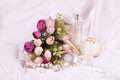 Perfume Bottles, White Rose And Pearls Beads Royalty Free Stock Photography - 25870787