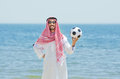 Arab With Footbal At Seaside Royalty Free Stock Photography - 25870977
