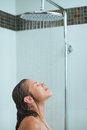 Woman With Long Hair Taking Shower Under Water Jet Stock Images - 25889284