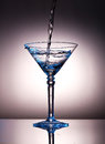 Pouring Liquor Into A Martini Glass Royalty Free Stock Images - 25891309