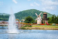 Colorful Garden With Romantic Windmill Royalty Free Stock Images - 25893859