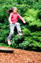Little Girl Leaps On Air Royalty Free Stock Photography - 2599657