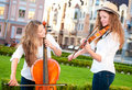 Two Women Strings Duet Playing Stock Photo - 25915030