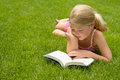 Girl Reading In The Grass Stock Image - 25952761
