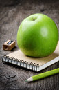Green Apple And School Supplies Stock Image - 25960141