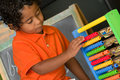 Child Using Abacus Stock Photography - 25972422