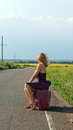 Fashionable Woman Hitchhiking At Roadside Royalty Free Stock Images - 25990149