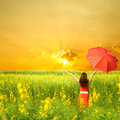 Happy Woman Holding Red Umbrella And Sunset Stock Photography - 26002422