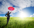 Woman Standing To Blue Sky  With Red Umbrella Royalty Free Stock Photos - 26002608