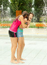 Teenage Girls Having Fun In The Towns Fountain Stock Images - 26002684