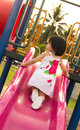 Child On A Slide In Playground Royalty Free Stock Photos - 26008638