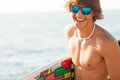 Young Surfer About To Get Into The Sea Royalty Free Stock Images - 26012429