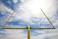 Football Goal Posts - Whispy White Clouds Blue Sky Royalty Free Stock Photography - 26042787