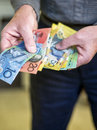 Handing Over All The Money Stock Photography - 26083962