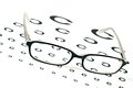 Glasses On A Eye Sight Test Chart Royalty Free Stock Photo - 26084725