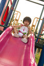 Child On A Slide In Playground Royalty Free Stock Images - 26091979