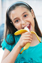 Cute Girl Eats An Banana Stock Photography - 26106512