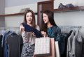 Two Girlfriends Go Shopping Stock Photography - 26127212