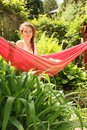 Girl Sit In A Hammock Royalty Free Stock Image - 26178406