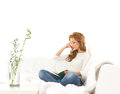 A Young Caucasian Woman Reading A Book On A Sofa Stock Photo - 26198100