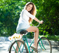 Woman And Bicycle Royalty Free Stock Photography - 26201137