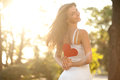 Woman With Red Heart Royalty Free Stock Photography - 26212107