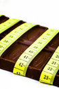 Chocolate And Tape Measure Royalty Free Stock Image - 26221196
