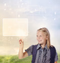 Young Blonde Girl Looking And Pointing Stock Image - 26229201